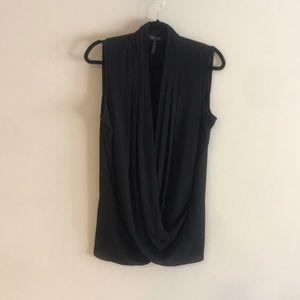 BCBG gauzy Blk sleeveless V neck blouse.